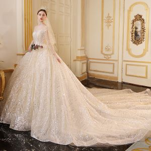 Sparkly Champagne See-through Wedding Dresses 2019 Ball Gown Scoop Neck Long Sleeve Backless Glitter Sequins Cathedral Train Ruffle
