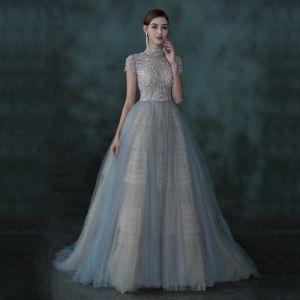 Illusion Bleu Ciel Transparentes Dansant Robe De Bal 2021 Robe Boule Col Haut Manches Courtes Perlage Longue Volants Dos Nu Robe De Ceremonie
