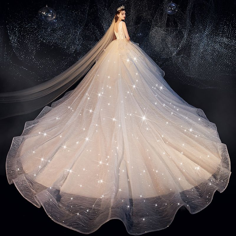 Bling Bling Champagne Wedding Dresses 2019 Ball Gown Deep V-Neck Sleeveless Backless Glitter Tulle Ruffle Cathedral Train