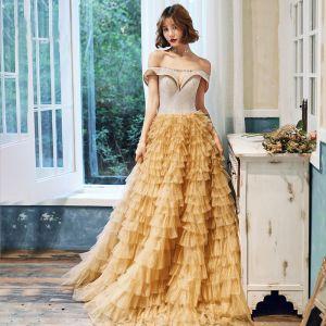 Flotte Guld Selskabskjoler 2020 Prinsesse Off-The-Shoulder Kort Ærme Glitter Tulle Lange Cascading Flæser Halterneck Kjoler