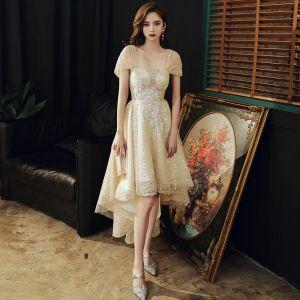 Błyszczące Złote Asymetryczny Sukienki Koktajlowe 2020 Princessa Przy Ramieniu Perła Cekiny Aplikacje Kótkie Rękawy Bez Pleców Sukienki Wizytowe