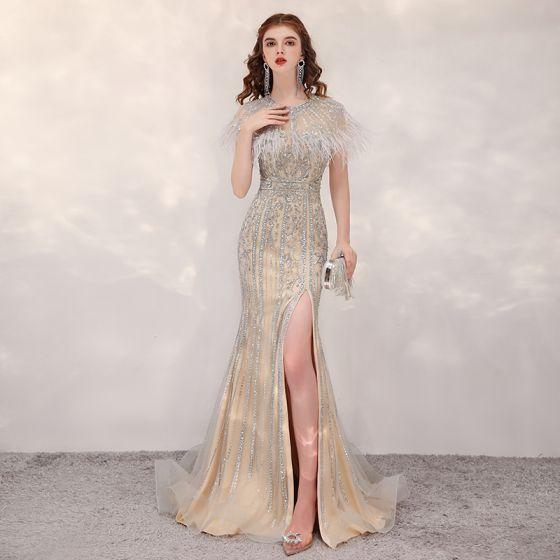 Luxus / Herrlich Gold Durchsichtige Abendkleider 2020 Meerjungfrau Rundhalsausschnitt Kurze Ärmel Perlenstickerei Feder Gespaltete Front Sweep / Pinsel Zug Festliche Kleider