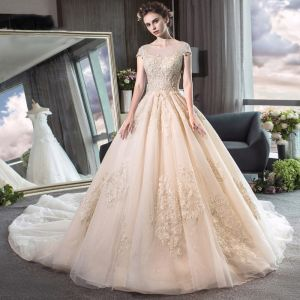 Elegant Champagne See-through Wedding Dresses 2019 A-Line / Princess Scoop Neck Cap Sleeves Backless Appliques Lace Beading Cathedral Train Ruffle