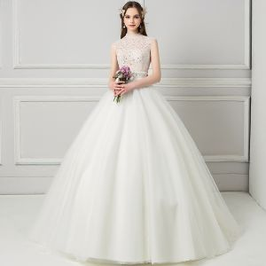 Chic / Beautiful Ivory See-through Wedding Dresses 2018 Ball Gown High Neck Sleeveless Backless Beading Pearl Rhinestone Ruffle Court Train