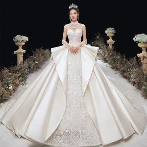 Luxury / Gorgeous Champagne Satin See-through Wedding Dresses 2020 Ball Gown High Neck Long Sleeve Backless Handmade  Beading Appliques Lace Cathedral Train Ruffle