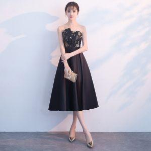 Sencillos Negro de fiesta Vestidos de graduación 2018 A-Line / Princess Sin Tirantes Sin Mangas Bordado Cinturón Té De Longitud Ruffle Sin Espalda Vestidos Formales