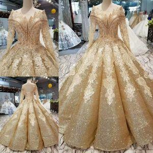 Luksusowe Złote Suknie Ślubne 2019 Suknia Balowa Cekinami Tiulowe Wycięciem Frezowanie Kryształ Kutas Z Koronki Kwiat Długie Rękawy Bez Pleców Trenem Królewski