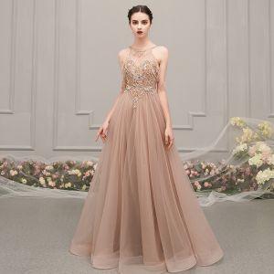 Luxe Champagne Transparentes Robe De Soirée 2019 Princesse Encolure Dégagée Sans Manches Faux Diamant Perlage Longue Volants Dos Nu Robe De Ceremonie