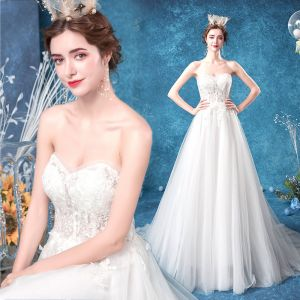Affordable Ivory Wedding Dresses 2020 A-Line / Princess Strapless Lace Flower Sleeveless Backless Sweep Train