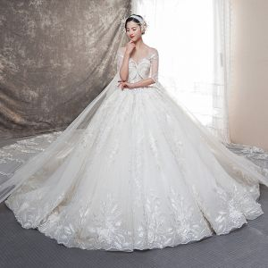 Illusion Champagne See-through Wedding Dresses 2019 Ball Gown Scoop Neck Backless Bell sleeves Beading Appliques Lace Watteau Train Ruffle