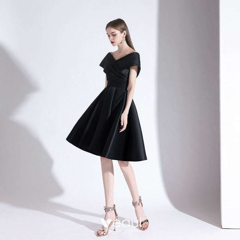 classy knee length black cocktail dress