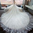 Luxury / Gorgeous Ivory Wedding Dresses 2018 Ball Gown V-Neck Short Sleeve Backless Glitter Tulle Beading Royal Train Ruffle