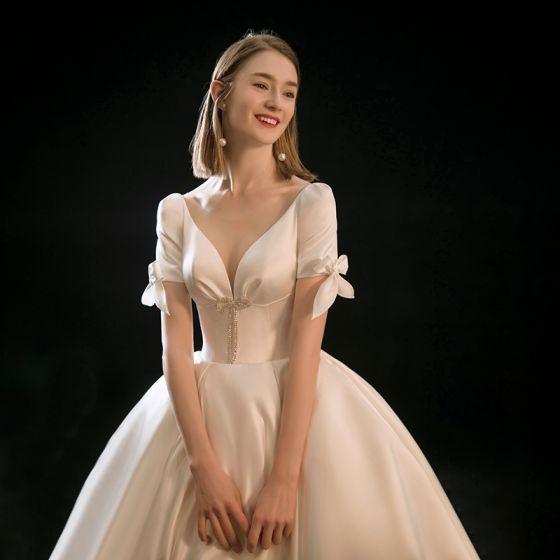 Vintage / Retro Champagne Satin Bridal Wedding Dresses 2020 Ball Gown See-through Deep V-Neck Short Sleeve Backless Bow Beading Chapel Train Ruffle