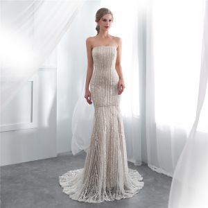 Chic / Beautiful Champagne Evening Dresses  2018 Trumpet / Mermaid Strapless Sleeveless Appliques Lace Court Train Ruffle Backless Formal Dresses