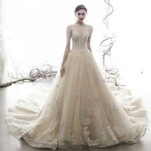 Vintage / Retro Champagne See-through Wedding Dresses 2019 A-Line / Princess High Neck Short Sleeve Beading Tassel Appliques Lace Cathedral Train Ruffle
