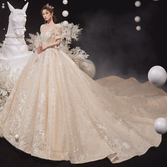 Victorian Style Champagne See-through Bridal Wedding Dresses 2020 Ball Gown Scoop Neck Puffy Short Sleeve Backless Appliques Lace Sequins Beading Cathedral Train Ruffle