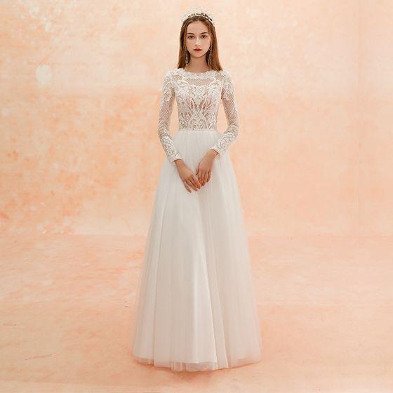 Illusion Ivory / Creme Strand Durchbohrt Brautkleider / Hochzeitskleider 2019 Etui Rundhalsausschnitt Lange Ärmel Applikationen Spitze Lange Rüschen