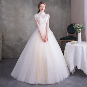 Vintage Ivory See-through Wedding Dresses 2018 Ball Gown High Neck 3/4 Sleeve Backless Appliques Flower Beading Pearl Ruffle Court Train