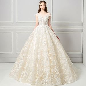 Elegant See-through Champagne Wedding Dresses 2018 Ball Gown V-Neck Cap Sleeves Backless Appliques Lace Pearl Ruffle Cathedral Train
