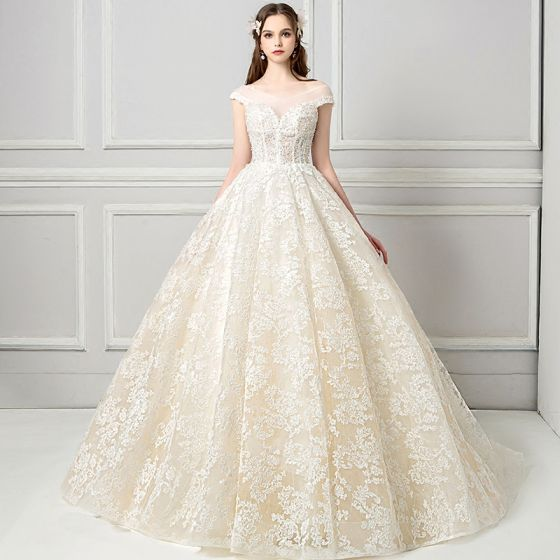 34f1b7ee7 elegant-see-through-champagne-wedding-dresses-2018-ball-gown-v-neck-cap- sleeves-backless-appliques-lace-pearl-ruffle-cathedral-train-560x560.jpg