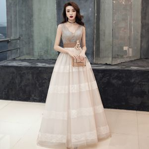 Elegant Champagne Prom Dresses 2019 Empire V-Neck Sleeveless Sash Appliques Lace Sweep Train Ruffle Backless Formal Dresses
