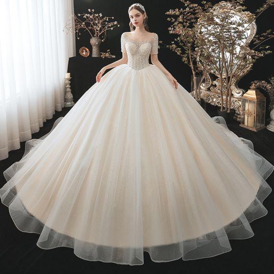 Mode Champagne Bröllopsklänningar 2021 Balklänning Urringning Beading Pärla Paljetter Korta ärm Halterneck Royal Train Bröllop