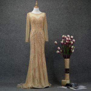 High End Gold Durchsichtige Abendkleider 2020 Meerjungfrau Rundhalsausschnitt Lange Ärmel Handgefertigt Perlenstickerei Sweep / Pinsel Zug Rüschen Festliche Kleider