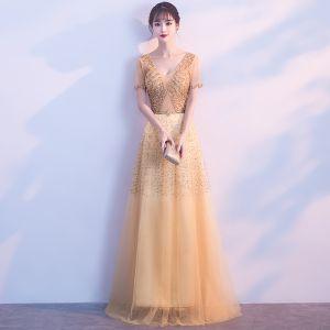 Schöne Gold Abendkleider 2018 A Linie V-Ausschnitt Tülle Rückenfreies Perlenstickerei Strass Pailletten Abend Festliche Kleider