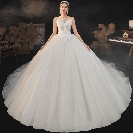Modest / Simple Champagne Bridal Wedding Dresses 2021 Ball Gown Sweetheart Sleeveless Backless Bow Glitter Tulle Cathedral Train Ruffle