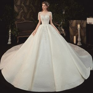Elegant Champagne Bridal Wedding Dresses 2020 Ball Gown See-through Scoop Neck Short Sleeve Backless Glitter Tulle Beading Tassel Appliques Lace Cathedral Train Ruffle