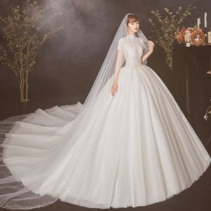 Vintage / Retro Ivory See-through Wedding Dresses 2020 Ball Gown High Neck Short Sleeve Appliques Lace Beading Pearl Cathedral Train Ruffle