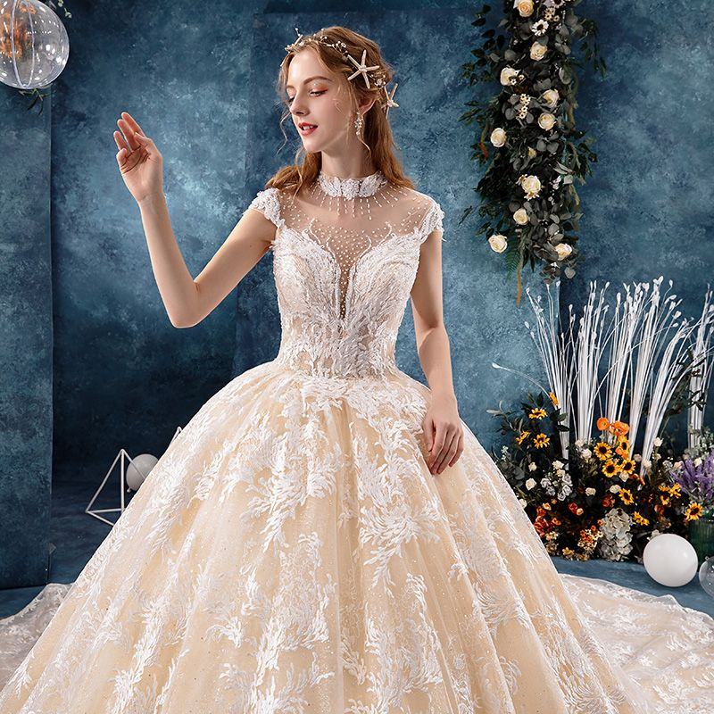 Vintage / Retro Champagne See-through Wedding Dresses 2019 Ball Gown High Neck Sleeveless Backless Heart-shaped Appliques Lace Handmade  Beading Royal Train Ruffle