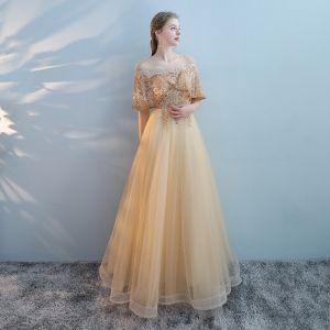 Charmant Doré Transparentes Robe De Bal 2018 Princesse Encolure Dégagée Manches Courtes Perle Perlage Faux Diamant Longue Volants Dos Nu Robe De Ceremonie