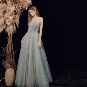 Elegantes Verde Salvia Bailando Vestidos de gala 2021 A-Line / Princess Sin Tirantes Sin Mangas Rebordear Glitter Tul Largos Ruffle Sin Espalda Vestidos Formales