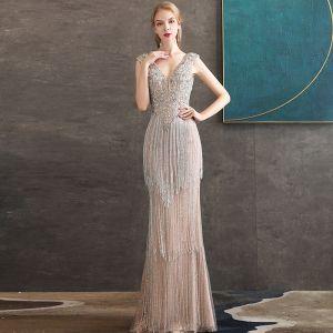 High End Champagner Abendkleider 2020 Meerjungfrau Tiefer V-Ausschnitt Ärmellos Perlenstickerei Quaste Lange Rüschen Rückenfreies Festliche Kleider