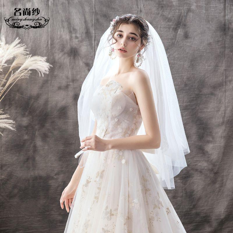 Schöne Champagner Brautkleider / Hochzeitskleider 2019 A Linie Bandeau Perle Spitze Blumen Rückenfreies Schleife Ärmellos Hof-Schleppe
