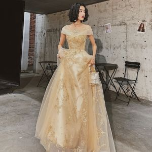Chic / Beautiful Gold Evening Dresses  2020 A-Line / Princess See-through Square Neckline Short Sleeve Appliques Sequins Floor-Length / Long Ruffle Backless Formal Dresses