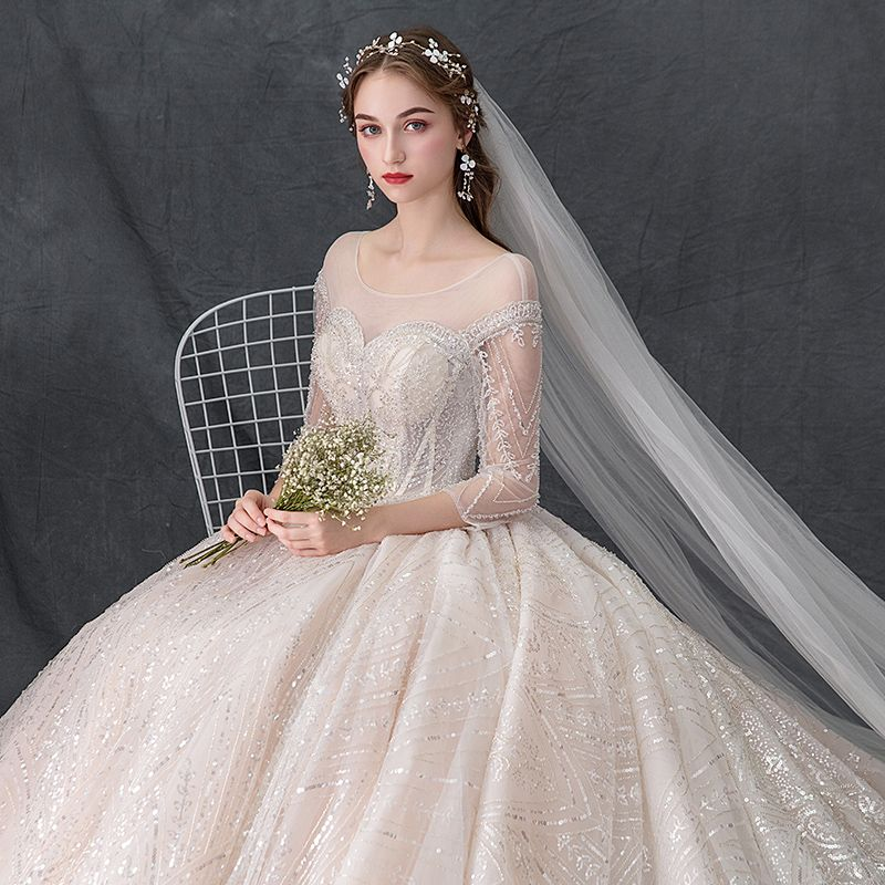 Luxury / Gorgeous Champagne See-through Wedding Dresses 2019 Ball Gown Scoop Neck 3/4 Sleeve Backless Handmade  Beading Glitter Tulle Cathedral Train Ruffle