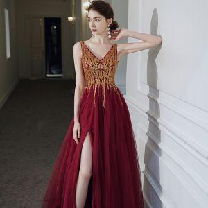 Wysokiej Klasy Czerwone Sukienki Na Bal 2020 Princessa V-Szyja Bez Rękawów Frezowanie Cekiny Podział Przodu Długie Wzburzyć Bez Pleców Sukienki Wizytowe