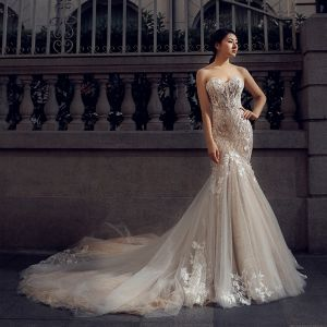 Charming Champagne Wedding Dresses 2018 Trumpet / Mermaid Sweetheart Sleeveless Backless Appliques Lace Glitter Tulle Chapel Train Ruffle