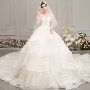 Luxury / Gorgeous Ivory See-through Wedding Dresses 2019 Ball Gown Scoop Neck 3/4 Sleeve Backless Beading Cathedral Train Cascading Ruffles