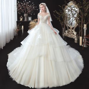 Romantic Ivory Bridal Wedding Dresses 2020 Ball Gown See-through Scoop Neck Short Sleeve Backless Appliques Lace Beading Tassel Cathedral Train Cascading Ruffles