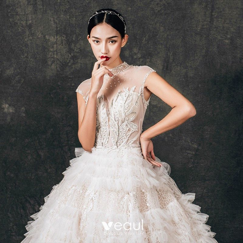 Charming See-through Champagne Lace Wedding Dresses 2019 Ball Gown High Neck Sleeveless Backless Appliques Lace Beading Cathedral Train Ruffle