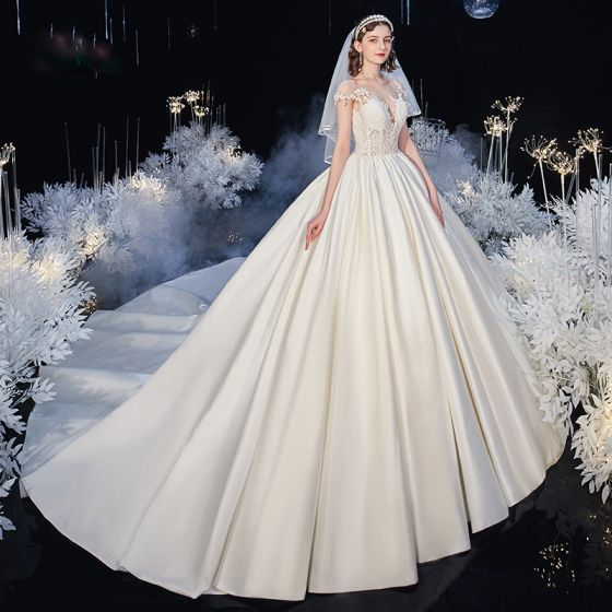 Illusion Ivory Satin Bridal Wedding Dresses 2020 Ball Gown See-through Scoop Neck Short Sleeve Backless Beading Appliques Lace Cathedral Train
