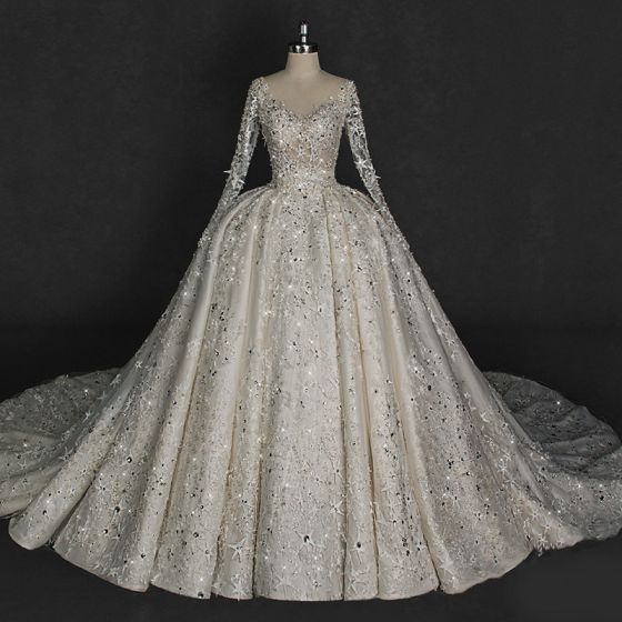 Illusion Ivory Wedding Dresses 2018 Ball Gown V-Neck Long Sleeve Backless Star Appliques Pierced Lace Glitter Rhinestone Cathedral Train Ruffle
