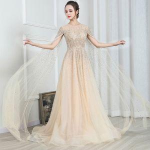 Wysokiej Klasy Złote Przezroczyste Sukienki Wieczorowe 2020 Princessa Wycięciem Kótkie Rękawy Frezowanie Trenem Watteau Wzburzyć Sukienki Wizytowe