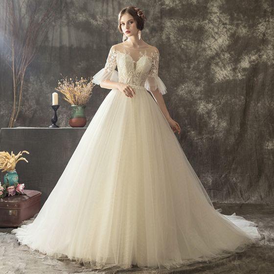 Illusion Champagne Transparentes Robe De Mariée 2019 Princesse Encolure Dégagée Manches de cloche Appliques En Dentelle Perle Glitter Tulle Tribunal Train Volants