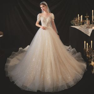 Victorian Style Champagne Bridal Wedding Dresses 2020 Ball Gown See-through Scoop Neck Puffy Short Sleeve Backless Beading Sequins Chapel Train Ruffle
