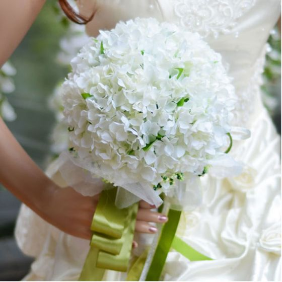 Fresh And Beautiful White Hydrangea Bridal Bouquets Holding
