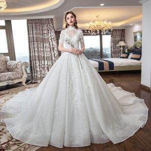 Luxury / Gorgeous Ivory See-through Wedding Dresses 2019 Ball Gown High Neck Short Sleeve Backless Beading Tassel Appliques Lace Glitter Tulle Cathedral Train Ruffle